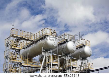 Storage tanks on a refinery plant - stock photo
