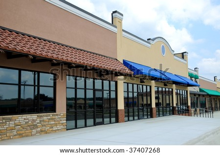 Store Fronts in a New Shopping Center - stock photo