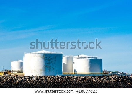 Storgae silos by the ocean in blue sky - stock photo