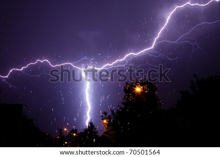 storm and lightning above the village - stock photo