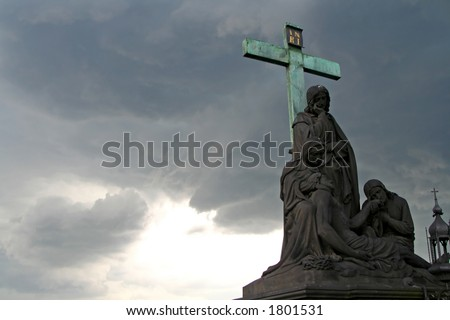 Storm and statue - stock photo