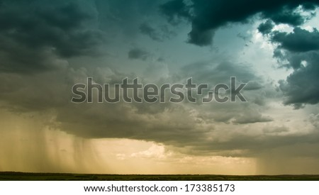 storm at sunset - stock photo