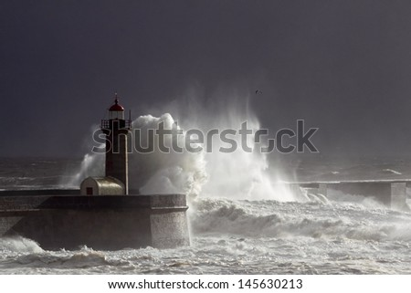 Storm at the harbor entrance of the river Douro. Low edition image; the light is coming from a momentary sunbeam. - stock photo