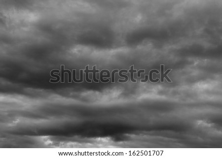 Storm clouds as if armageddon Rainy clouds over horizon - stock photo