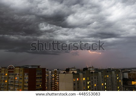 Storm clouds, heavy rain. Thunderstorm and lightning over the city. - stock photo