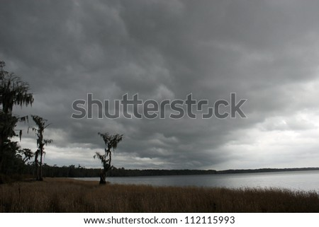 storm clouds over lake - stock photo