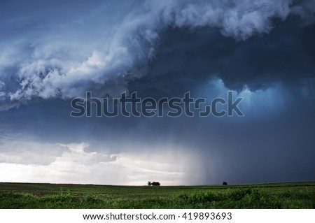 Storm Clouds over planted fields in Vojvodina, Serbia, copyspace included - stock photo