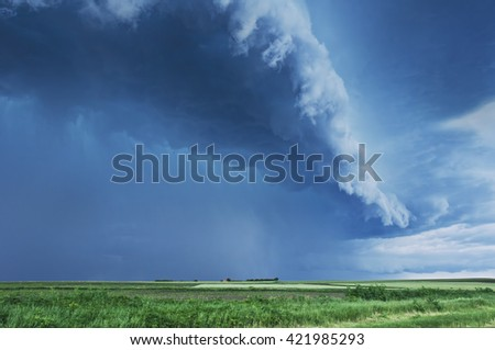 Storm Clouds over planted fields in Vojvodina, Serbia. Copyspace included - stock photo