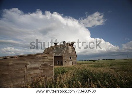 Storm clouds over Saskatchewan homestead - stock photo