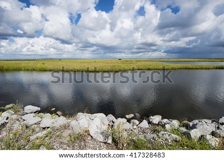 Storm Clouds over the Louisiana Marsh at Grand Isle - stock photo