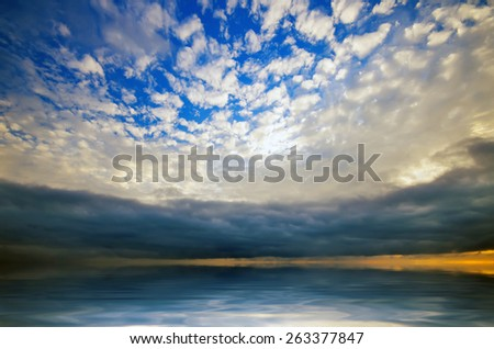 Storm clouds over the sea and light cirrus clouds in the foreground. natural composition - stock photo