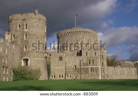 Storm clouds rising over Windsor Castle - stock photo
