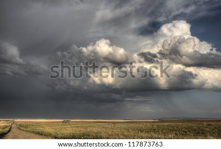 Storm Clouds Saskatchewan billowing clouds and gravel road - stock photo