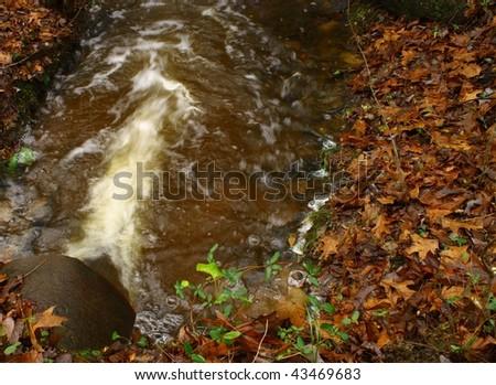 Storm drain runoff - stock photo