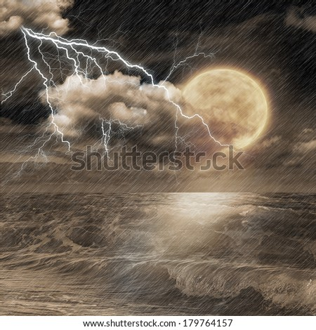storm evening on ocean and the moon - stock photo
