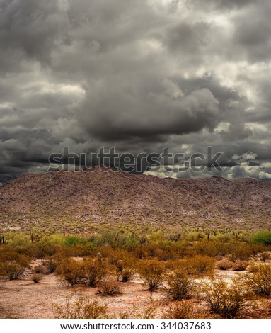 Storm forming Sonora desert mountains in central Arizona USA - stock photo