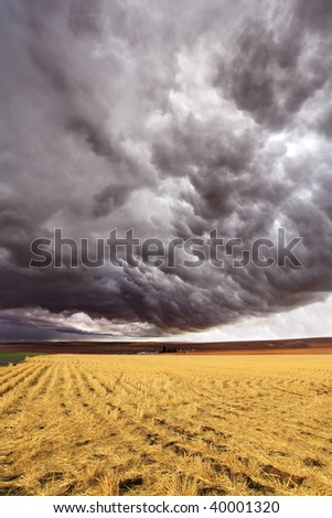 Storm front. A huge thundercloud above fields of Montana, the USA - stock photo