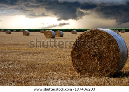storm front with bales of straw - stock photo