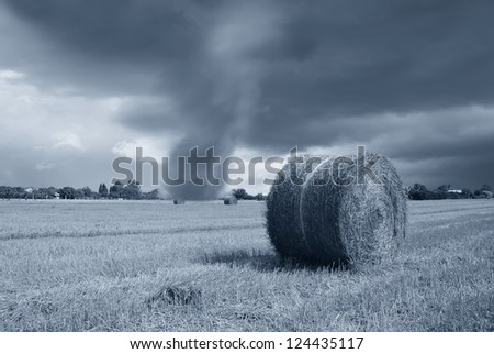 storm incoming over countryside in june - stock photo