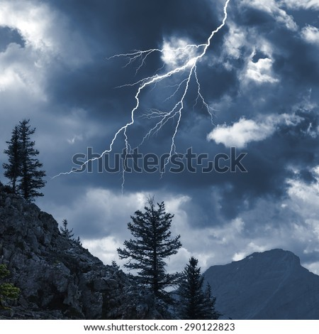 Storm lighting in the Rocky mountains. Canada - stock photo