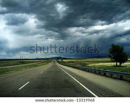 "Storm on the Horizon v2 is a highway headed into a vicious ""monsoon"" thunder storm with strong winds in New Mexico - stock photo"