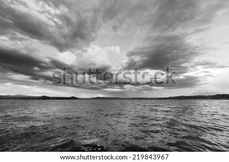 storm on the lake black and white - stock photo
