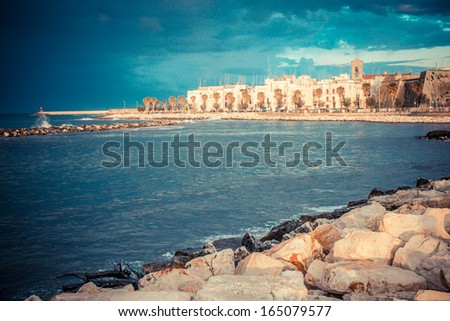 Storm over the harbor in Mola di Bari, south of Italy - stock photo