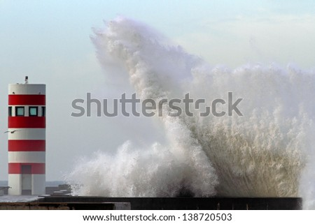 Storm wave over lighthouse - stock photo