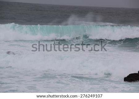 Storm Waves: A view of the pacific sea on a stormy day - stock photo