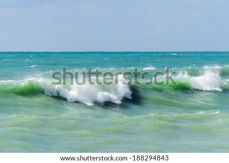 Storm waves on the sea shallows. Stormy weather. - stock photo