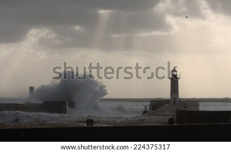 Storm waves over the Lighthouse, Portugal - stock photo