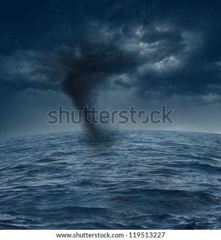 stormy clouds and tornado over the ocean - stock photo