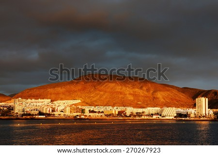 Stormy clouds over Los Cristianos resort in Tenerife, Canary Islands, Spain - stock photo