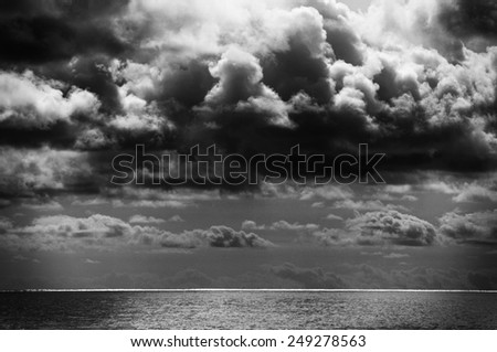 Stormy clouds over the ocean - stock photo