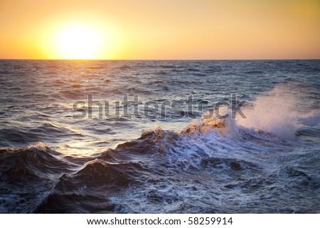 Stormy sea / Dawn / Waves and spray / horizontal / Wallpaper - stock photo