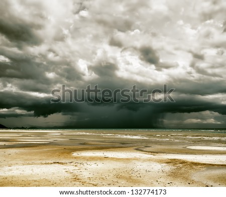 Stormy sky and beach at low tide. - stock photo