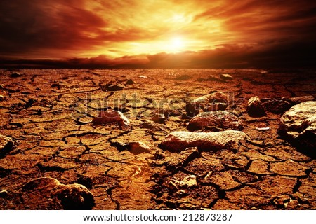 Stormy sky over desert - stock photo