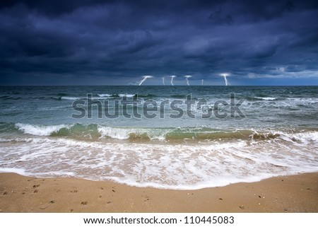 Stormy sky over the sea deserted beach. Bad weather at sea. Off Season - stock photo