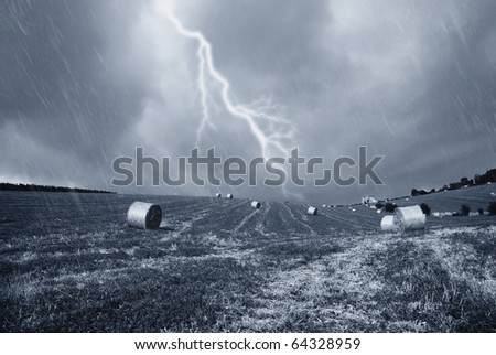 stormy sky with rain on the countryside - stock photo