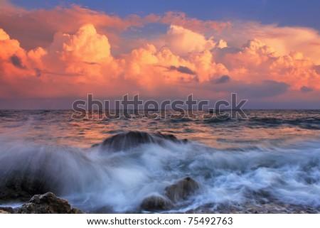 Stormy sunrise in ocean bay - stock photo