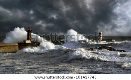 Stormy sunset at the harbor of the mouth of the river Douro, in Porto, Portugal, with big waves against old lighthouse, new pier and beacon; enhanced sky - stock photo