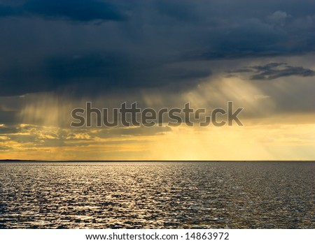 Stormy sunset over the sea - stock photo