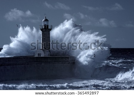 Stormy waves over old lighthouse and pier of the Douro river  mouth entry. Used infrared filter. Toned blue. - stock photo