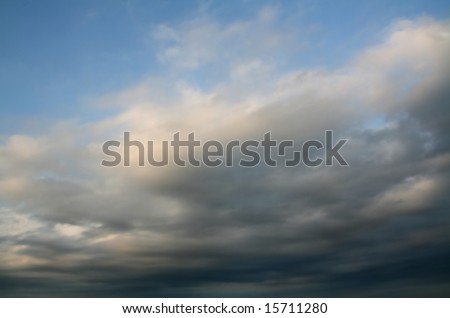 stormy weather at summer, dark clouds over blue sky - stock photo