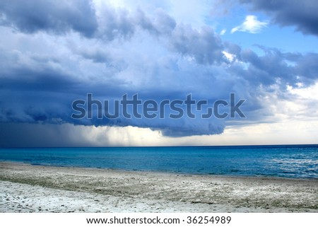 Stormy weather with rain on the beach. Before a powerful storm - stock photo