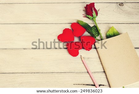story love,Hearts, roses, pencil and book on wood - stock photo