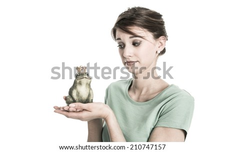 Story of frog king - young isolated woman in love concept. Sad and disappointed girl with broken heart. - stock photo