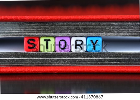 Story word written on colorful cube dice - stock photo