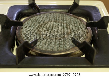 Stove and gas fueled ring in a kitchen - stock photo