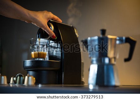 Stove top italian espresso coffee maker or Moka pot and modern coffee machine  - stock photo